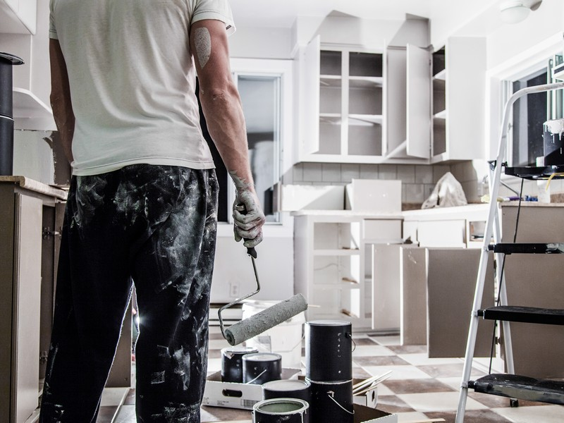 A man renovating a house